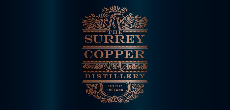The Surrey Copper Distillery logo on blue background
